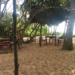 The outdoor area where the sand, sea and the food are all available.