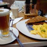 Red Cappuccino, scrambled eggs with low GI toast in front with a GEM smoothie featured at the ba