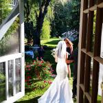 Bride in backyard of Hartwell House Inn