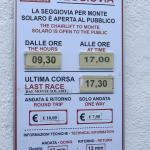 Mt. Solaro chairlift sign with times and prices