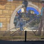 One of many murals painted on the Mississippi River flood wall.