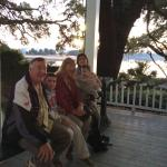 Sitting on the Joggling Board, front porch overlooking the river
