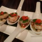 Seared scallops with a zingy salsa served on spoons.