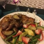 Roast Chicken with vegetables topped with strawberries and pine nuts?