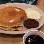 Egg, sausage and two pancakes