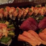 Lava Roll (bottom left), Monster Roll (along the top), 2 orders of Tuna and Salmon sashimi.