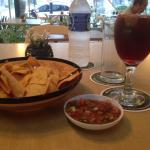 Plain chips, tomato salsa, and house sangria!