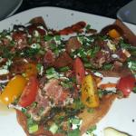 Must try the  Ahi Tuna Nachos and sample the rotating craft beers.