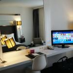 Mirror in front of the bed with TV and a place where you can work (if you want to)