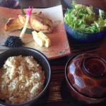 Fish with salad, miso soup and rice.