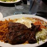 Steak and green chile enchiladas with egg