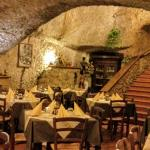 The large dining room is carved out of the tufo rock