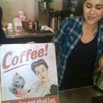 One of the Baristas holding a sign