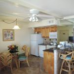 Kitchen in one bedroom condo. All units have a full kitchen so you don't have to alwasy dine out