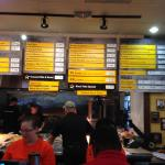 Menu Items on a Board Above The Cooking & Serving Counter