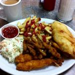 The deicious seafood platter - halibut, breaded shrimp and clam strips,.chips and coleslaw