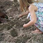 Our daughter learning about gardening with Moumin