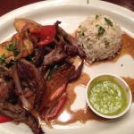 Lomo Saltado a la Peruana with yucca and rice