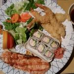Combo platter with salmon, shrimp tempura, California Roll, and salad. Delicious!