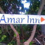 sign on main street puerto morelos one block off town square pointing lane to amar inn