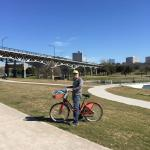 Red biking along Trinity River.Bike stand is 1 block from hotel. $8 a day.