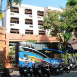 Front of hotel with tour bus and biker's bikes