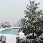 the pool with views of the lake after snowfall