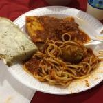 Spaghetti, meatball, ravioli and bread from Trattoria Di Napoli