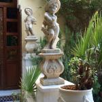 statues at the entrance to the living spaces