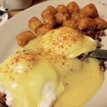 The Crow's Nest: Eggs Benedict nestled in valleys of corned beef hash. & the luscious tater tots