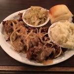 Fried chicken livers, cabbage, mashed potatoes, and biscuit