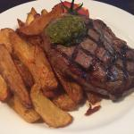 Ribloin medium rare with hand cut chips and grilled tomato