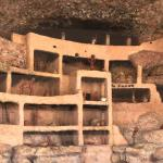 Cut-away view of cliff dwelling interior. Trail hut has a recorded explanation.