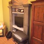TV and room design. No storage for clothes.