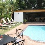 The swimming pool with breakfast area to the rear at Eltham Lodge, Port Elizabeth.