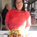 Sasha with her octopus and salad, there was an option for chips with this meal