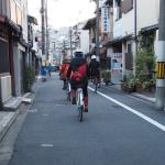 Cycling through the backstreets of Kyoto behind our guide, Keiko.