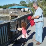 Grandpa and Daisy buying fish food