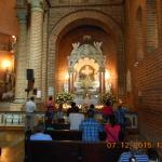 Inside the Catedral of Girardota at one of the Altars, where most people burn a candle and pray.