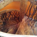The spiral staircase to the cupola made from wood mostly found on the property.