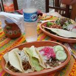 Tacos on one plate quesadilla and volcanes on the other