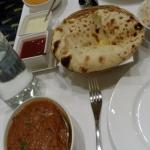 Lamb curry, naan and another curry.