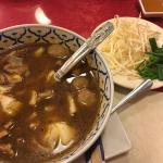 Beef noodle soup with wide rice noodles (veggies on the side), pineapple chicken, and chicken sa