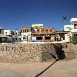Panorama of hotel from beach looking back to rooms and pool