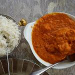 Aangara Alu-Fusion with chicken and mashed potatoes colour yellow, served with basmati rice