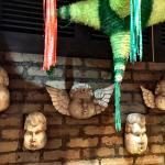 Angels on the wall and pinatas on the ceiling :)
