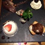 Assiete of desserts - strawberry panna cotta, choc delice, morello cherry bavarois
