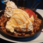 Apple Crisp.. Sliced apples with a oatmeal crisp on top with vanilla ice cream and whipped cream