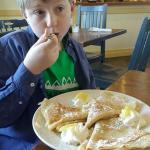 My son with  his Traditional Crepes with lemon and powdered sugar