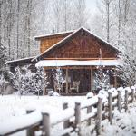 A private luxury cabin in the winter; one of four types of lodging available at The Ranch.